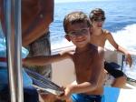 Prima volta in barca, già al timone